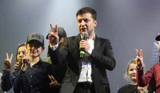 In this Friday, March 29, 2019, file photo, Volodymyr Zelenskiy, Ukrainian actor and candidate in the upcoming presidential election, hosts a comedy show at a concert hall in Brovary, Ukraine. Ukraine's presidential runoff on Sunday, April 21, is a battle between a billionaire tycoon who rode anti-Russian protests to the nation's top office five years ago, and a comedian who plays a president in a TV sitcom. The actor has used humor and social media to take pole position. (AP Photo/Efrem Lukatsky, file)