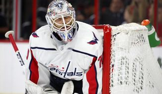 Washington Capitals goaltender Braden Holtby (70) guards the net against the Carolina Hurricanes during the second period of Game 4 of an NHL hockey first-round playoff series, in Raleigh, N.C, Thursday, April 18, 2019. (AP Photo/Karl B DeBlaker)