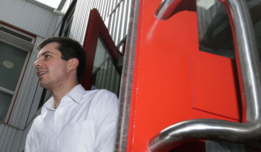 Democratic presidential candidate South Bend Mayor Pete Buttigieg smiles as he heads to his van after a campaign stop at a dairy company in Londonderry, N.H., Friday, April 19, 2019. (AP Photo/Charles Krupa)
