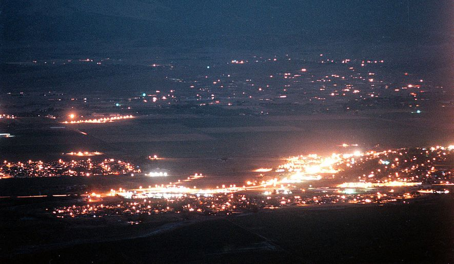 This July 22, 1999, photo shows lights along Highway 395 in Minden, Nev. A Democratic leader in rural Nevada says she's tired of presidential candidates saying it's too costly and time-consuming to visit far-flung towns. Kimi Cole of the Rural Nevada Democratic Caucus, who lives in Minden, tells The Associated Press that she and others are setting up a series of virtual visits with the Democrats running for president. The online video conferences they hope to launch within a month could be a nationwide model. (Rick Gunn/Nevada Appeal via AP, File)