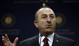 Turkish Foreign Minister Mevlut Cavusoglu speaks to the media during a news conference with Polish Foreign Minister Jacek Czaputowicz and Romanian Foreign Minister Teodor Melescanu following a meeting of political-military consultations between the NATO countries, in Ankara, Turkey, Friday, April 19, 2019. Cavusoglu says the United States has yet to respond to a Turkish proposal to set up a technical committee to review possible security threats Russia's S-400 missile defense system could pose to the U.S. F-35 fighter jet program.(AP Photo/Burhan Ozbilici)