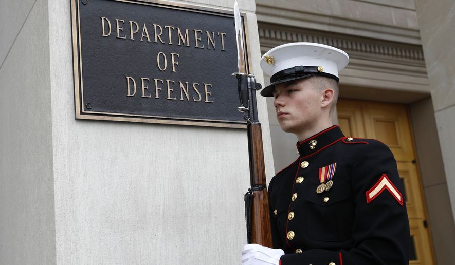 A member of the U.S. Marine Corps participates in an arrival ceremony for Japan's Defense Minister Takeshi Iwaya at the Pentagon, Friday, April 19, 2019, in Washington. (AP Photo/Patrick Semansky)