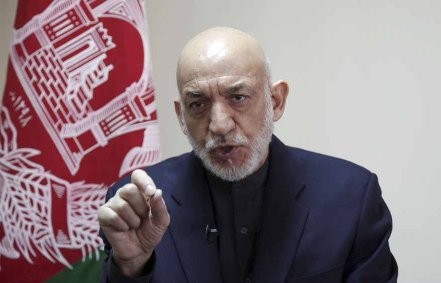 FILE - In this Feb. 16, 2019, file photo, former Afghan President Hamid Karzai speaks during an interview with The Associated Press in Kabul, Afghanistan. Karzai said Friday, April 19, 2019 that peace in his homeland, ravaged by more than 17 years of war, will not be possible until Afghans from all sectors of society sit together and negotiate _ including the Taliban.(AP Photo/Rahmat Gul, File)