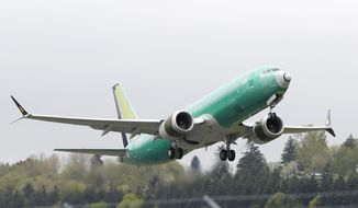 FILE - In this Wednesday, April 10, 2019 file photo, a Boeing 737 MAX 8 airplane being built for India-based Jet Airways, takes off on a test flight at Boeing Field in Seattle. A global team of experts next week will begin reviewing how the Boeing 737 Max's flight control system was approved by the U.S. Federal Aviation Administration. The FAA says experts from nine international civil aviation authorities have confirmed participation in a technical review promised by the agency.  (AP Photo/Ted S. Warren, File)