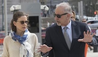 Clare Bronfman, left, arrives at Federal court with her attorney Mark Geragos in the Brooklyn borough of New York, Friday, April 19, 2019. Bronfman has pleaded guilty to charges implicating her in a sex-trafficking conspiracy case against an upstate New York self-help group. (AP Photo/Mary Altaffer)