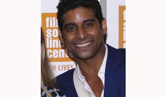 RETRANSMISSION TO CORRECT SPELLING OF NAME TO CATAZARO - FILE - This May 24, 2017 file photo shows ballet dancer Amar Ramasar when he attended a screening at the Elinor Bunin Munroe Film Center, in New York. An arbitrator has ordered New York City Ballet to reinstate fired dancers Ramasar and Zachary Catazaro  who were fired for sharing nude photos of women and sexually explicit texts. The pair were named in a lawsuit by a former student at the company's affiliated school. City Ballet said it believes it was within its rights to fire the dancers but will abide by the ruling. (Photo by Brent N. Clarke/Invision/AP, File)