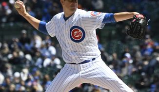 Chicago Cubs starting pitcher Kyle Hendricks (28) throws against the Arizona Diamondbacks during the first inning of a baseball game, Friday, April 19, 2019, in Chicago. (AP Photo/David Banks)
