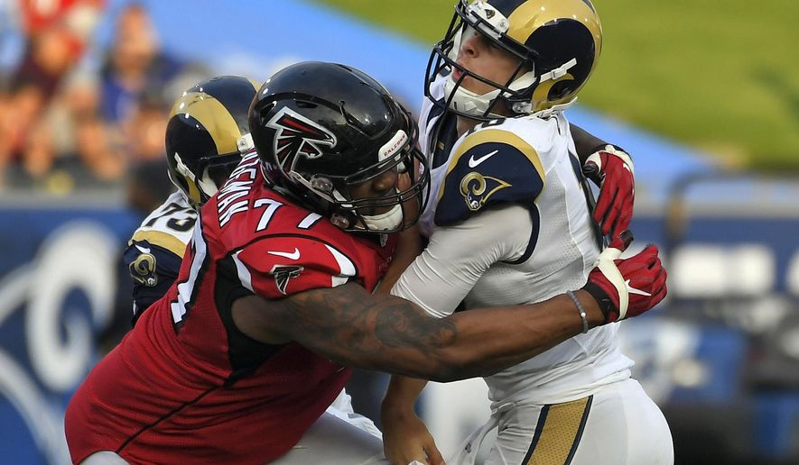 FILE - In this Dec. 11, 2016, file photo, Los Angeles Rams quarterback Jared Goff, right, is hit by Atlanta Falcons defensive tackle Ra'Shede Hageman during the second half of an NFL football game in Los Angeles. The Falcons have signed Hageman, giving a second chance to the defensive tackle the team released in 2017 after he was charged with domestic violence. (AP Photo/Mark J. Terrill, File)