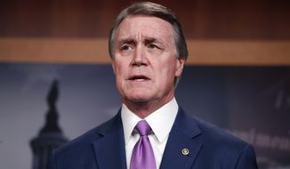 In this Monday, Feb. 12, 2018, file photo, Sen. David Perdue, R-Ga., speaks during a news conference about an immigration bill on Capitol Hill in Washington. (AP Photo/Alex Brandon, File)
