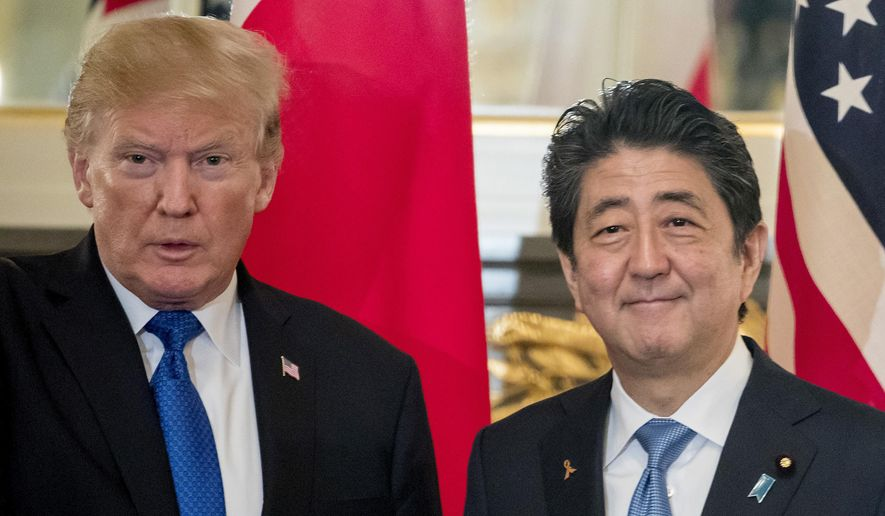 In this Nov. 6, 2017, file photo, U.S. President Donald Trump, left, and Japanese Prime Minister Shinzo Abe shake hands before a bilateral meeting at the Akasaka Palace in Tokyo. Trump will make a state visit to Japan at the end of May 2019 to meet the nation's new emperor. (AP Photo/Andrew Harnik, File)