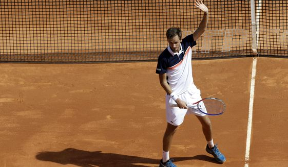 Russia's Daniil Medvedev reacts after defeating Serbia's Novak Djokovic in their quarterfinal match of the Monte Carlo Tennis Masters tournament in Monaco, Friday, April 19, 2019. (AP Photo/Claude Paris)