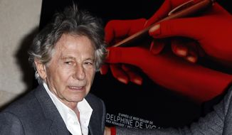 """FILE - In this Oct. 30, 3017 file photo director Roman Polanski poses a photo  prior to the screening of """"Based on a true story"""" in Paris, France. Roman Polanski is asking a judge to restore his membership in the Academy of Motion Picture Arts and Sciences after he was expelled for misconduct last year. Lawyers for the 85-year-old director filed documents Friday, April 19, 2019 requesting that a court compel the academy to make him a member in good standing again. (AP Photo/Francois Mori, File)"""