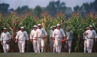 """FILE - In this undated file photo, people portraying ghost players emerge from a cornfield as they reenact a scene from the movie """"Field of Dreams"""" at the movie site in Dyersville, Iowa. It's been 30 years since the film was released. (AP Photo/Charlie Neibergall, File)"""