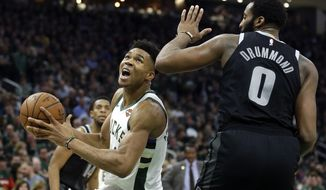 Milwaukee Bucks' Giannis Antetokounmpo drives to the basket against Detroit Pistons' Andre Drummond during the second half of Game 2 of an NBA basketball first-round playoff series Wednesday, April 17, 2019, in Milwaukee. The Bucks won 120-99. (AP Photo/Aaron Gash)