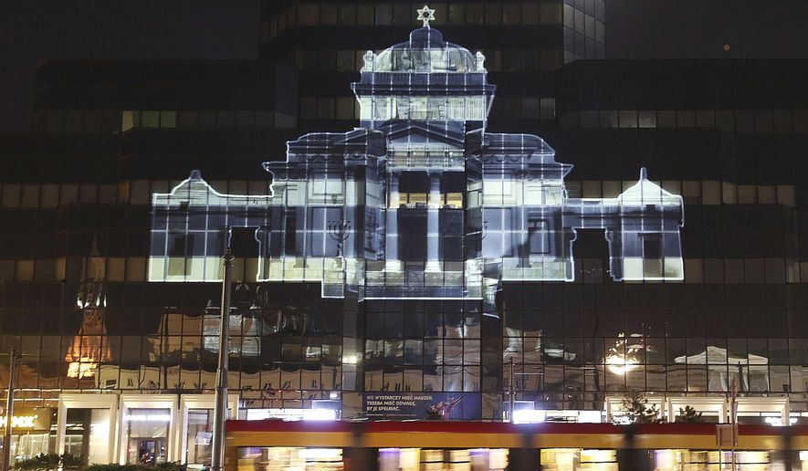 The Great Synagogue of Warsaw, which was destroyed by the German forces during World War II, was recreated virtually with light as part of anniversary commemorations of the 1943 uprising in the Warsaw Ghetto, in Warsaw, Poland, Thursday, April 18, 2019. The multimedia installation, which included the archival recordings of a prewar cantor killed in the Holocaust, is the work of Polish artist Gabi von Seltmann. It was organized by a group that fights anti-Semitism.(AP Photo/Czarek Sokolowski)
