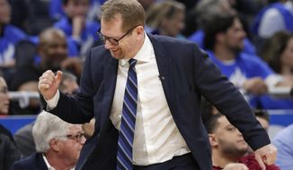 Toronto Raptors head coach Nick Nurse pumps his fist after his team scored a basket against the Orlando Magic during the second half in Game 3 of a first-round NBA basketball playoff series, Friday, April 19, 2019, in Orlando, Fla. (AP Photo/John Raoux)