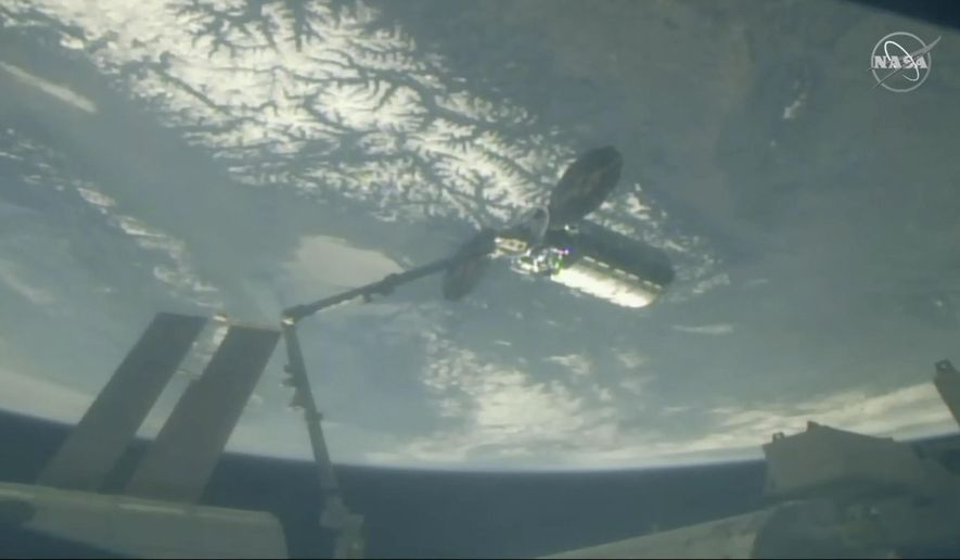 In this image taken from NASA Television, Cygnus capsule arrives at the International Space Station with food galore, following a 1 1/2-day journey from Virginia, Friday, April 19, 2019. Space station astronaut Anne McClain used a robot arm to capture the capsule as they soared 250 miles (402.32 kilometers) above Earth. (NASA TV via AP)