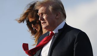 President Donald Trump and first lady Melania Trump, walk down the stairs of Air Force One during their arrival at Palm Beach International Airport, Thursday, April 18, 2019, in West Palm Beach, Fla. Trump traveled to Florida to spend the Easter weekend as his Mar-a-Lago estate. (AP Photo/Pablo Martinez Monsivais)