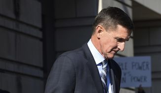 In this Dec. 1, 2017, photo, former Trump national security adviser Michael Flynn leaves federal court in Washington. (AP Photo/Susan Walsh) **FILE**
