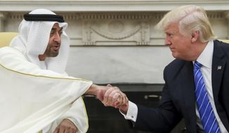 In this May 15, 2017, file photo, President Donald Trump shakes hands with Abu Dhabi's crown prince, Sheikh Mohammed bin Zayed Al Nahyan, in the White House in Washington. (AP Photo/Andrew Harnik, File)