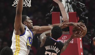Los Angeles Clippers guard Lou Williams, right, shoots as Golden State Warriors center Kevon Looney defends during the first half in Game 3 of a first-round NBA basketball playoff series Thursday, April 18, 2019, in Los Angeles. (AP Photo/Mark J. Terrill)