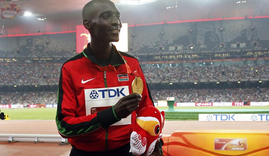 FILE - In this file photo dated Sunday, Aug. 30, 2015, Kenya's Asbel Kiprop shows his gold medal after winning the men's 1500m final at the World Athletics Championships at the Bird's Nest stadium in Beijing, Sunday, Aug. 30, 2015. Former Olympic and three-time world champion Asbel Kiprop of Kenya was banned for four years Saturday for testing positive for the blood-boosting drug EPO after his claim that urine samples might have been tampered with by disreputable doping control officers was rejected. (AP Photo/Ng Han Guan, FILE)