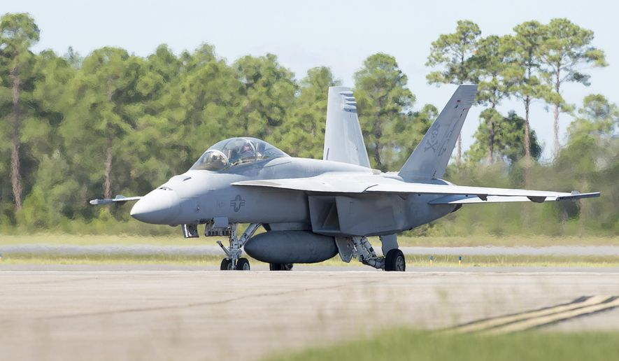 In this Sept. 12, 2018 photo, an F/A-18 Super Hornet aircraft from Naval Air Station Oceana taxis after landing at Naval Air Station Pensacola, Fla.. The Blue Angels are tentatively scheduled to start flying the F/A-18 Super Hornet in 2021, the team's 75th anniversary season. The move to the Super Hornet will mark the first time the elite Navy and Marine fighter jet demonstration team has changed aircraft since it moved from the A-4F Skyhawk II to the F/A-18 Hornet back in 1986. (Gregg Pachkowski//Pensacola News Journal via AP)