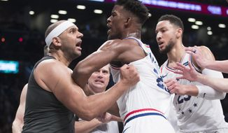 CORRECTS TO SECOND HALF NOT FIRST HALF - Brooklyn Nets forward Jared Dudley, left, and Philadelphia 76ers guard Jimmy Butler (23) get into a shoving match during the second half of Game 4 of a first-round NBA basketball playoff series, Saturday, April 20, 2019, in New York. (AP Photo/Mary Altaffer)
