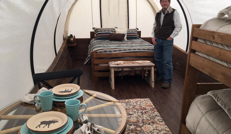 Kansas couple designs covered wagons for 'glamping' - Washington Times