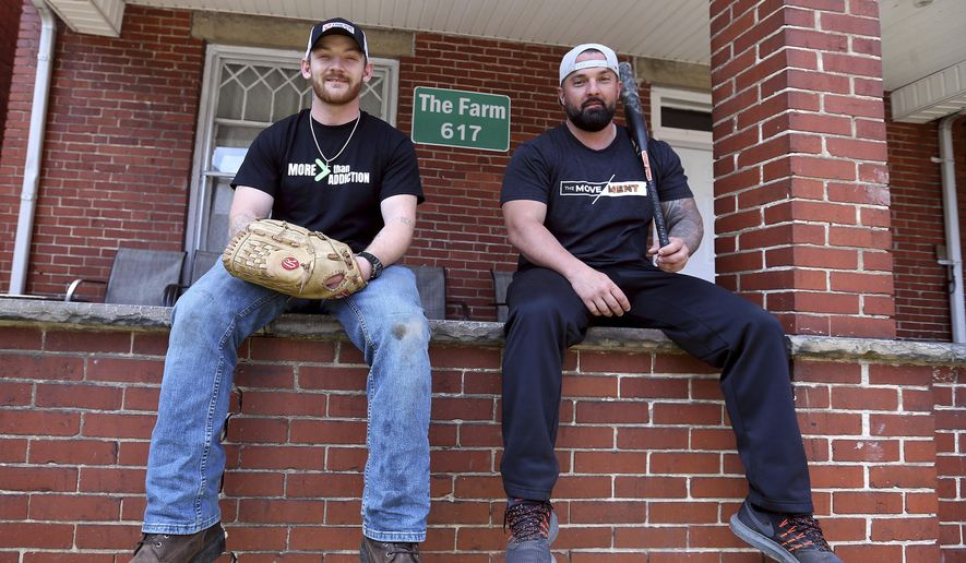 In this April 10, 2019 photo, Adam Foster, left, and Craig Hettlinger have organized a ten-team softball league for recovering addicts in the Huntington, W.Va. area and are in search of donations to get the league off the ground. (Lori Wolfe/The Herald-Dispatch via AP)