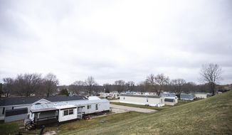 This April 5, 2019, photo shows the West Branch Village mobile home park in West Branch, Iowa. Mobile home owners who for years have enjoyed some immunity from rising housing costs are increasingly finding themselves subjected to massive rent increases, not just in Iowa, but across the country. (Joseph Cress/Iowa City Press-Citizen via AP)