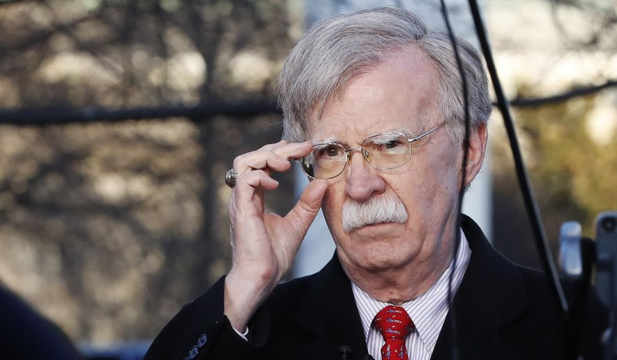 In this March 5, 2019, file photo, U.S. National Security Adviser John Bolton adjusts his glasses before an interview at the White House in Washington. (AP Photo/Jacquelyn Martin, File)