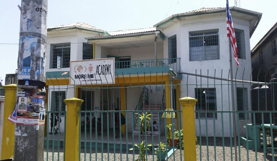 FILE - This Oct 12, 2018 file photo shows the More Than Me Academy in Monrovia, Liberia. On Friday, April 19, 2019, Katie Meyler, who established the charity to help vulnerable girls in Liberia, announced her resignation in the wake of allegations that a staffer raped several girls in its care. It comes six months after she had taken a leave of absence. (AP Photo/Jonathan Paye-Layleh)