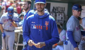 New York Mets' Jacob deGrom stands in the dugout prior to a baseball game against the St. Louis Cardinals, Saturday, April 20, 2019, in St. Louis. (AP Photo/Scott Kane)