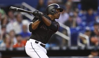Miami Marlins' Curtis Granderson (21) hits a home run during the fifth inning of a baseball game against the Washington Nationals on Saturday, April 20, 2019, in Miami. (AP Photo/Brynn Anderson)