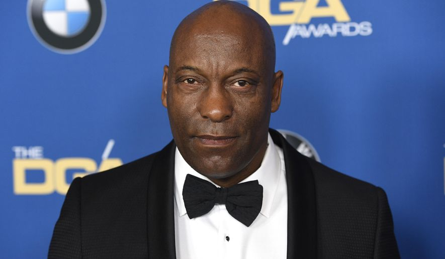 In this Feb. 3, 2018, file photo, John Singleton arrives at the 70th annual Directors Guild of America Awards in Beverly Hills, Calif. (Photo by Chris Pizzello/Invision/AP)
