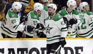 Dallas Stars right wing Alexander Radulov (47), of Russia, is congratulated after scoring against the Nashville Predators during the second period in Game 5 of an NHL hockey first-round playoff series Saturday, April 20, 2019, in Nashville, Tenn. (AP Photo/Mark Humphrey)