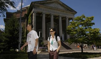 Freshman Liuxu Yang, of China, right, follows graduate student Cao Ou, of China, on a tour of the Syracuse University campus in Syracuse, N.Y., Friday, Aug. 26, 2005. (AP Photo/Kevin Rivoli) **FILE**