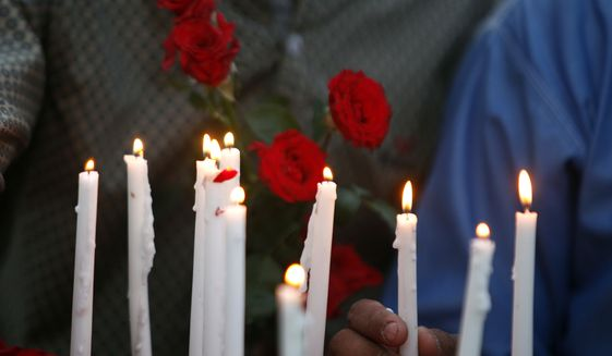 Pakistani Christians hold a candle light vigil for the for the victims of bomb explosions in churches and hotels in Sri Lanka, in Peshawar, Pakistan, Sunday, April 21, 2019. (AP Photo/Mohammad Sajjad)