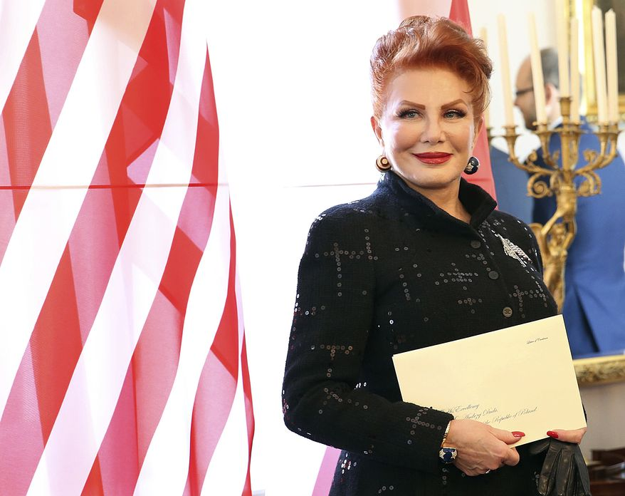 In this Sept. 6, 2018, file photo, Georgette Mosbacher stands next to an American flag after receiving her credentials as new United States ambassador to Poland in Warsaw. Ambassador Georgette Mosbacher wished Jews a happy Passover in Polish, and the reaction has been a wave of angry comments on Twitter. Mosbacher was accused of offending the country with her Passover tweet on Friday, April 19, 2019, and was reminded she serves in a predominantly Roman Catholic country. (AP Photo/Czarek Sokolowski, File)