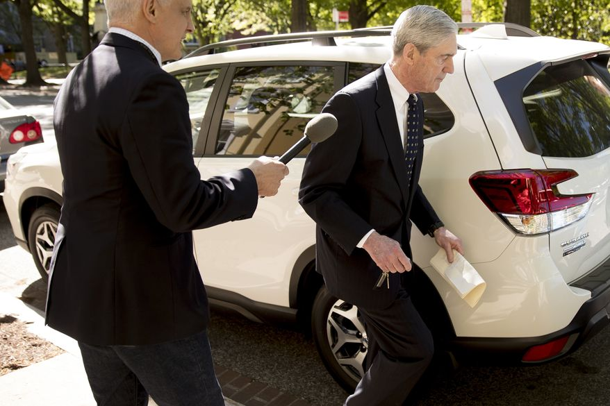 A reporter speaks to Special Counsel Robert Mueller, center, as he departs Easter services at St. John's Episcopal Church, Sunday, April 21, 2019, in Washington. (AP Photo/Andrew Harnik)