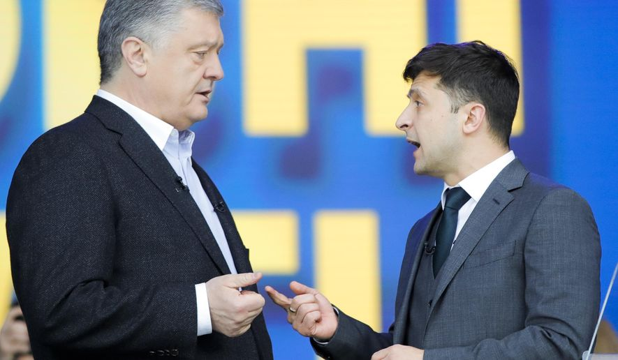 Ukrainian President Petro Poroshenko, left, and Ukrainian presidential candidate and popular comedian Volodymyr Zelenskiy, right, argue their debates at the Olympic stadium in Kiev, Ukraine, Friday, April 19, 2019. Friday is the last official day of election canvassing in Ukraine as all presidential candidates and their campaigns will be barred from campaigning on Saturday, the day before the vote.(AP Photo/Vadim Ghirda)