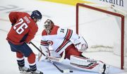 Washington Capitals center Nic Dowd (26) shoots and proceeds to score a penalty shot against Carolina Hurricanes goaltender Petr Mrazek (34), of the Czech Republic, during the third period of Game 5 of an NHL hockey first-round playoff series, Saturday, April 20, 2019, in Washington. The Capitals won 6-0. (AP Photo/Nick Wass) ** FILE **
