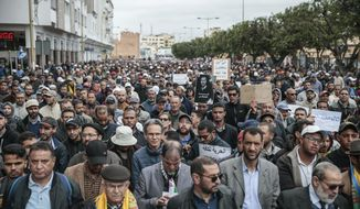 Thousands of Moroccans take part in a demonstration in Rabat, Morocco, Sunday, April 21, 2019. Protesters are condemning prison terms for the leader of the Hirak Rif protest movement against poverty and dozens of other activists. (AP Photo/Mosa'ab Elshamy)