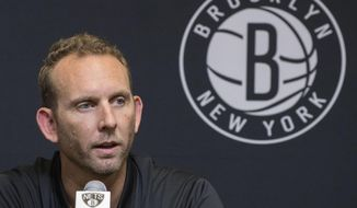FILE - This June 18, 2018, file photo shows Brooklyn Nets General Manager Sean Marks during a news conference introducing the team's draft picks in New York. NBA League Operations president Byron Spruell said Marks will serve a one-game suspension and be fined $25,000 for entering the referees' locker room after Game 4 of the Nets-76ers playoff series Saturday. (AP Photo/File, Mary Altaffer)