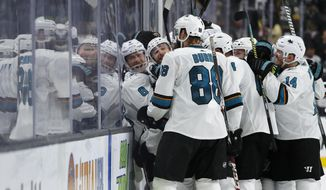 San Jose Sharks celebrate after defeating the Vegas Golden Knights in Game 6 of a first-round NHL hockey playoff series Sunday, April 21, 2019, in Las Vegas. (AP Photo/John Locher)