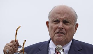 In this Aug. 1, 2018, file photo, Rudy Giuliani, an attorney for President Donald Trump, speaks in Portsmouth, N.H.  (AP Photo/Charles Krupa, File) ** FILE **