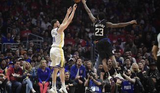 Golden State Warriors guard Klay Thompson, left, shoots as Los Angeles Clippers guard Lou Williams defends during the first half in Game 4 of a first-round NBA basketball playoff series Sunday, April 21, 2019, in Los Angeles. (AP Photo/Mark J. Terrill)