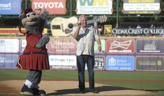 FILE - In this Saturday, June 7, 2014 file photo, former Philadelphia Phillies manager Charlie Manuel gets ready to throw out the first pitch during an appearance before a Lehigh Valley IronPigs baseball game against the Indianapolis Indians in Allentown, Pa. The Philadelphia Phillies Triple-A team are named for the pig iron that is a byproduct of the steel this region is renowned for producing. (AP Photo/The Express-Times, Matt Smith)
