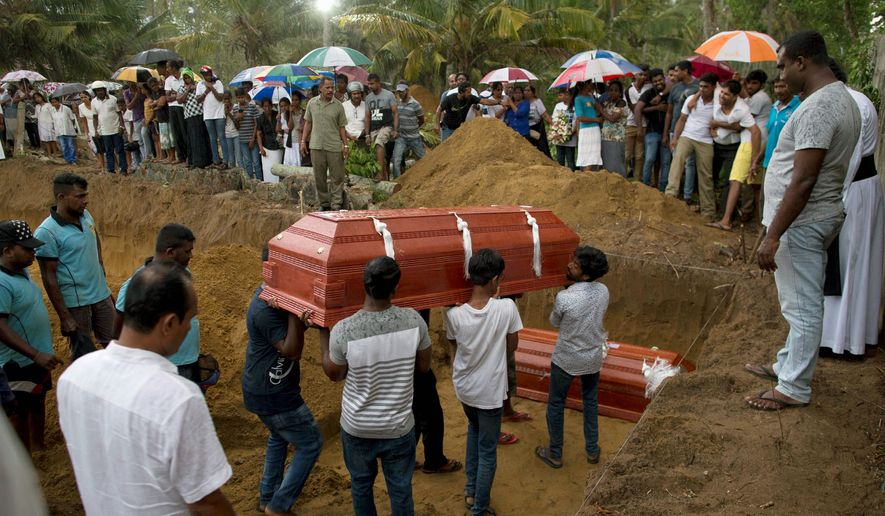 Relatives carry a coffin for burial during the funerals of three members of the same family, all died at Easter Sunday bomb blast at St. Sebastian Church in Negombo, Sri Lanka, Monday, April 22, 2019. Easter Sunday bombings of churches, luxury hotels and other sites was Sri Lanka's deadliest violence since a devastating civil war in the South Asian island nation ended a decade ago. (AP Photo/Gemunu Amarasinghe)